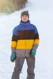Snowboarder odprowadzenie w zima dniu Zdjęcie Stock