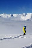 Snowboarder on off-piste slope with new fallen snow Stock Images