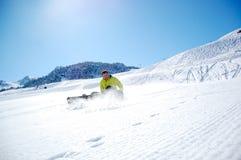 Snowboarder op Sneeuw stock foto's