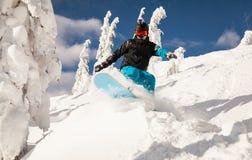 Snowboarder på lutningarna Arkivbilder