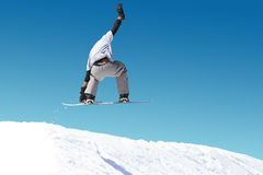 Snowboarder performing jump Royalty Free Stock Photo