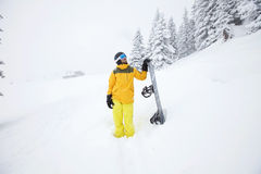 Snowboarder planning descent Royalty Free Stock Image