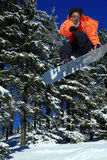 Snowboarder point at you during a jump stock image