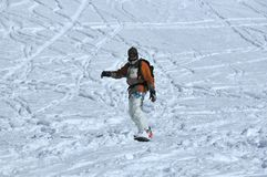 Snowboarder in powder snow with walkie-talkie Royalty Free Stock Photography