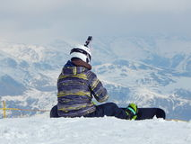 A snowboarder is preparing for the ride. Stock Photography