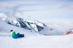 Snowboarder. Preparing to ride a mountain at Almaty Chimbulak resort Stock Photos