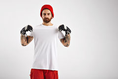 Snowboarder presenting unlabeled white t-shirt royalty free stock photography