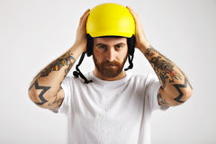 Snowboarder putting on and adjusting helmet Stock Image