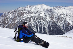 Snowboarder que se relaja Imagen de archivo libre de regalías