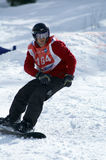Snowboarder on race Stock Photo