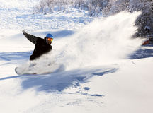 Snowboarder racing down Stock Photos