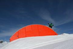 Snowboarder on rainbow rail Stock Photos