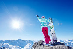 Snowboarder with raised hand in mountains Royalty Free Stock Image