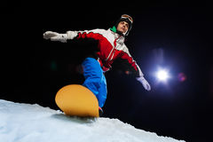 Snowboarder ready to slide down the mountain Royalty Free Stock Photos