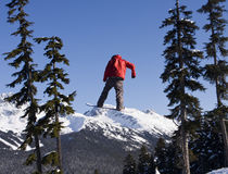 Snowboarder In Red Coat Stock Images
