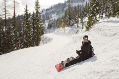 Snowboarder resting Stock Photos