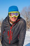 Snowboarder resting on the ski resort Stock Image