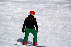 Snowboarder in motion, the snowboarder on the ski slope Stock Image
