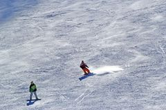 Snowboarder in motion, the snowboarder on the ski slope Stock Photos