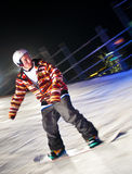 Snowboarder rides at night. Stock Images