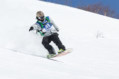 Snowboarder rides steep mountains on Kamchatka. Far East, Russia Royalty Free Stock Photo