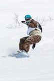 Snowboarder rides steep mountains. Kamchatka, Far East, Russia Royalty Free Stock Photos