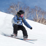 Snowboarder rides steep mountains. Kamchatka, Far East, Russia Royalty Free Stock Photography