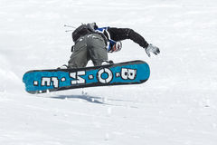 Snowboarder rides steep mountains. Kamchatka, Far East, Russia Stock Image