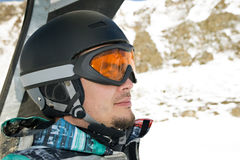 Snowboarder riding a chairlift. Profile headshot Stock Photos