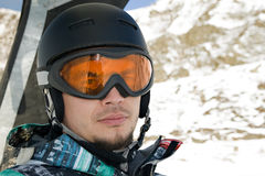 Snowboarder riding a chairlift. Front view headshot Stock Image