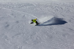 Snowboarder riding deep powder snow Royalty Free Stock Photography