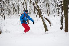 Snowboarder is riding in a deep snow Stock Images