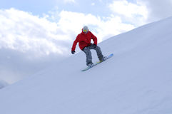 Snowboarder riding down the slope Royalty Free Stock Photography
