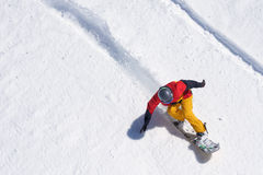 Snowboarder riding on loose snow Freeride. Top view Stock Image