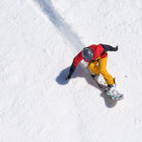 Snowboarder riding on loose snow Freeride. Top view Stock Photos