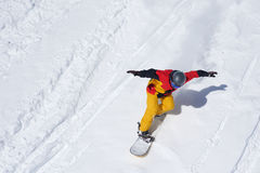 Snowboarder riding on loose snow Freeride. Top view Royalty Free Stock Photography