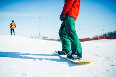 Snowboarder riding a snow hill, extreme sport. Snowboarder riding a snow hill. Winter extreme sport, active lifestyle. Snowboarding in mountains Stock Images