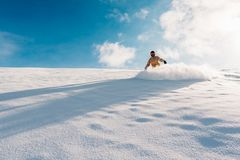 Snowboarder is riding from snow hill Stock Image