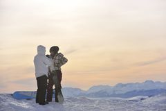 Snowboarder's couple on mountain's top Royalty Free Stock Images