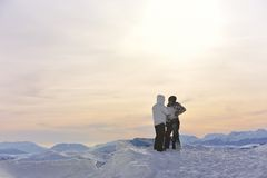 Snowboarder's couple on mountain's top Stock Photo