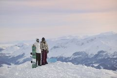 Snowboarder's couple on mountain's top Stock Images