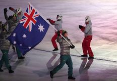 Snowboarder Scotty James carrying the flag of Australia leading the Australian Olympic team at the PyeongChang 2018 Winter Olympic. PYEONGCHANG, SOUTH KOREA Royalty Free Stock Photos