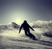 Snowboarder silhouette Stock Photos