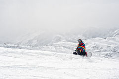 Snowboarder sit at top of mountain Royalty Free Stock Image