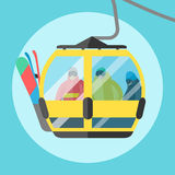 Snowboarder sitting in ski gondola and lift elevators. Winter sport resort background Stock Photo