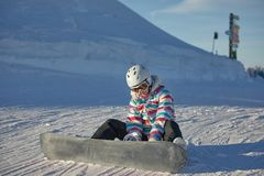 Snowboarder sitting in the snlow royalty free stock image