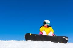 Snowboarder sitting snow mountain slope copy space Royalty Free Stock Photography