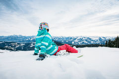Snowboarder sitting on snow Royalty Free Stock Photo