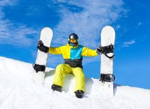 Snowboarder sitting snow slope snowboards Royalty Free Stock Photos