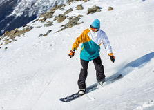 Snowboarder at a ski resor Stock Photo